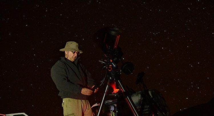Person using telescope