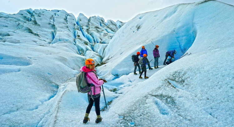 tourist hiking on gray glacier