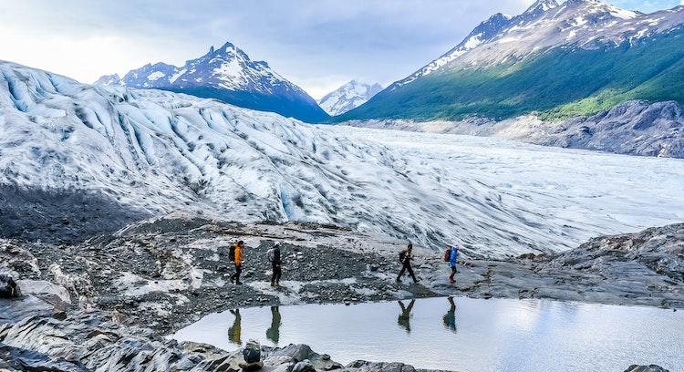 tourists walking on glacier grey