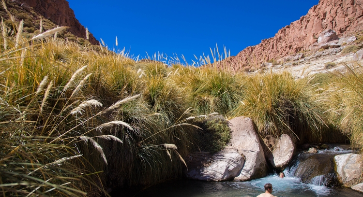 Tourists in puritama hot springs in San Pedro de Atacama