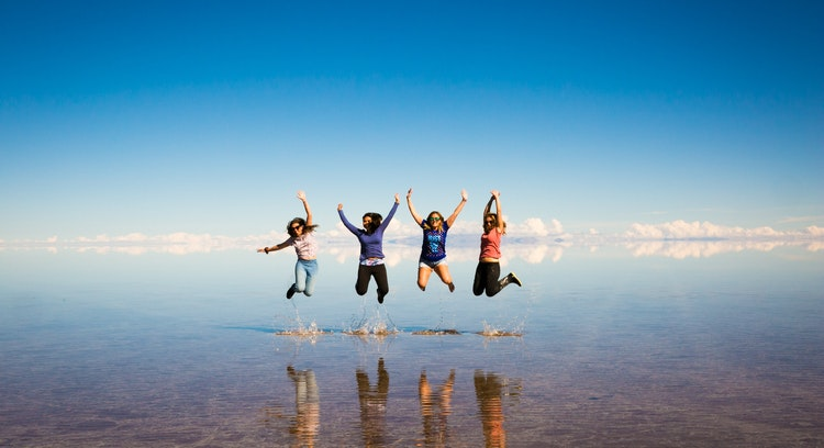 Jump over water Uyuni Salt Flat
