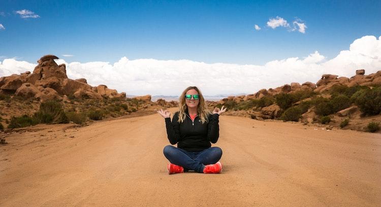 Woman sitting on the road to the Uyuni Salt Flat.